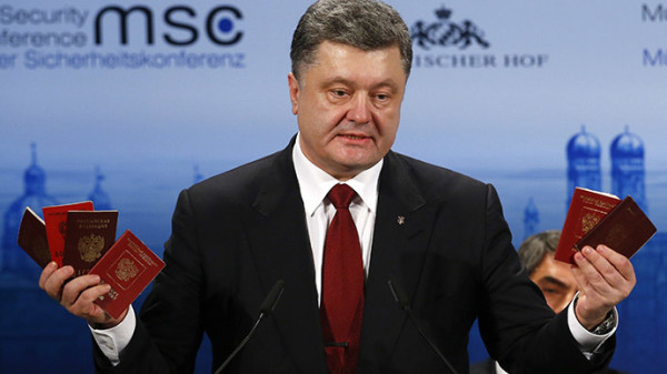 Ukraine's President Petro Poroshenko holds Russian passports to prove the presence of Russian troops in Ukraine as he addresses during the 51st Munich Security Conference at the 'Bayerischer Hof' hotel in Munich February 7, 2015. (Reuters/Michael Dalder)