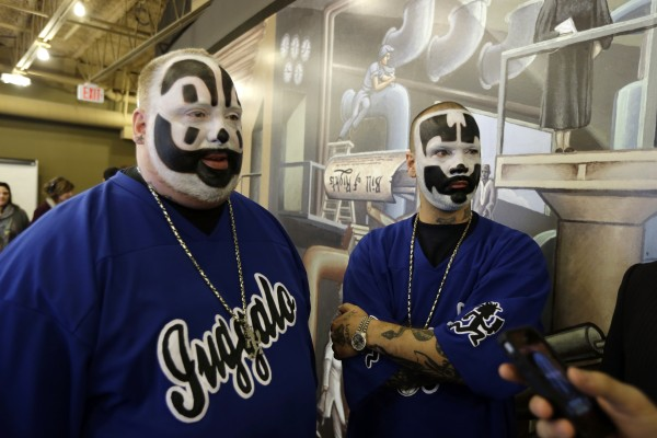 Joseph Bruce aka Violent J, left, and Joseph Utsler aka Shaggy 2 Dope, members of the Insane Clown Posse are seen after a news conference in Detroit, Wednesday, Jan. 8, 2014. The rap metal group sued the U.S. Justice Department on Wednesday over a 2011 FBI report that describes the duo's devoted fans, the Juggalos, as a dangerous gang, saying the designation has tarnished their fans' reputations and hurt business. The American Civil Liberties Union filed the lawsuit in Detroit federal court on behalf of the group's two members. (AP Photo/Carlos Osorio)