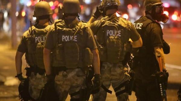 453768602-police-advance-on-demonstrators-protesting-the-killing.jpg.CROP.rtstory-large