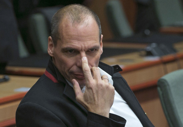 Greek Finance Minister Yanis Varoufakis waits for the start of an extraordinary euro zone Finance Ministers meeting (Eurogroup) to discuss Athens' plans to reverse austerity measures agreed as part of its bailout, in Brussels February 20, 2015. Greece has made every effort to reach a mutually beneficial agreement with its euro zone partners but will not be pushed to implement its old bailout programme, its government spokesman said on Friday.  REUTERS/Yves Herman (BELGIUM - Tags: POLITICS BUSINESS TPX IMAGES OF THE DAY) - RTR4QGAY