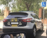 Woman fined for Facebook pic of police car in disabled spot
