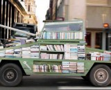 ARTIST TURNS CAR INTO A TANK ARMED WITH 900 BOOKS TO BE GIVEN AWAY FOR FREE