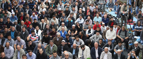 BERLIN, GERMANY - SEPTEMBER 19: Muslims gather for Friday prayers on the street outside the Mevlana Moschee mosque on a nation-wide action day to protest against the Islamic State (IS) on September 19, 2014 in Berlin, Germany. Muslims across cities in Germany followed a call by the country's Central Council of Muslims to protest against the ongoing violence by IS fighters in Syria and Iraq. (Photo by Sean Gallup/Getty Images)