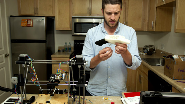 Cody Wilson works on the first completely 3D-printed handgun, The Liberator, at his home in Austin on Friday May 10, 2013. (AP Photo/Austin American Statesman, Jay Janner) AUSTIN CHRONICLE OUT, COMMUNITY IMPACT OUT, INTERNET MUST CREDIT PHOTOGRAPHER AND STATESMAN.COM