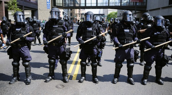Police officers in riot gear monitor a rally from the State Capitol to the Xcel Center, site of the Republican National Convention (RNC), in St. Paul, Minnesota, U.S., on Monday, Sept. 1, 2008. The RNC will be held from Sept. 1-4. Photographer: Keith Bedford/Bloomberg News