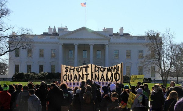 WASHINGTON DC, UNITED STATES - JANUARY 11: Protesters hold banners during a protest in front of the White House in Washington D.C, USA on January 11, 2016. The protesters demand from government to close the Guantanamo detention center at the US base in Guantanamo Bay of Cuba prior to its 14th anniversary of foundation. (Photo by Erkan Avci/Anadolu Agency/Getty Images)