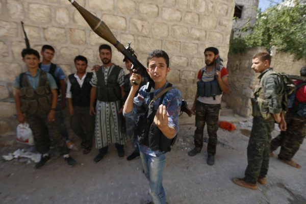 Syrian rebels once supported by U.S. appear to behead child in video