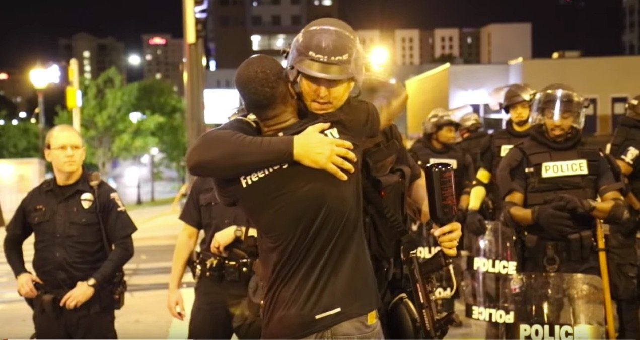 #FreeHugs Black Man Embraces Charlotte Police Exposes Hatred Of Black Lives Matter