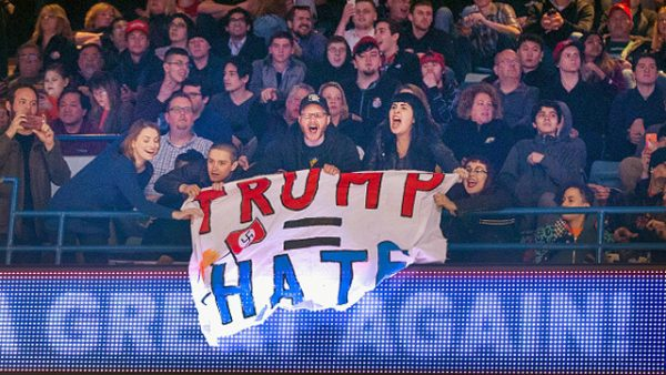 CHICAGO, IL - MARCH 11: Demonstrators react after learning a rally for Republican presidential candidate Donald Trump at the University of Illinois at Chicago would be postponed on March 11, 2016 in Chicago, Illinois. The campaign decided to postpone the rally, citing safety concerns, after learning hundreds of demonstrators were given tickets for the event. (Photo by Scott Olson/Getty Images)