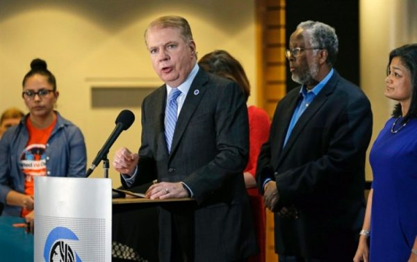 """FILE - In this Nov. 9, 2016, file photo, Seattle Mayor Ed Murray, second left, speaks at a post-election event of elected officials and community leaders at City Hall in Seattle. Leaders in Seattle, San Francisco and other so-called """"sanctuary cities"""" say they won't change their stance on immigration despite President-elect Donald Trump's vows to withhold potentially millions of dollars in taxpayer money if they don't cooperate. (AP Photo/Elaine Thompson, File) - See more at: http://www.timescolonist.com/news/obituaries/mayors-of-sanctuary-cities-say-they-ll-fight-trump-s-deportation-plans-1.2741412#sthash.AUw8j8iJ.dpuf"""