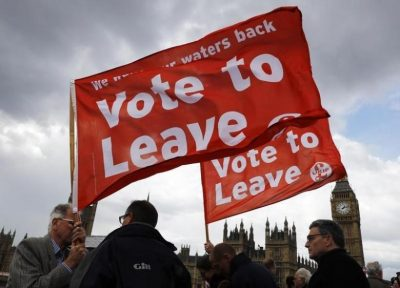 Leave the European Union campaigners wave banners near Parliament in London