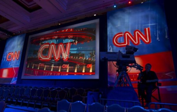 A CNN camera operator waits by his camera as the network prepares  for the first democratic presidential candidate debate at the Wynn Hotel in Las Vegas