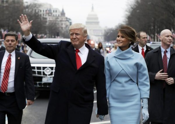 Donald Trump and first lady Melania Trump walk during the inaugural parade from the U.S. Capitol in Washington
