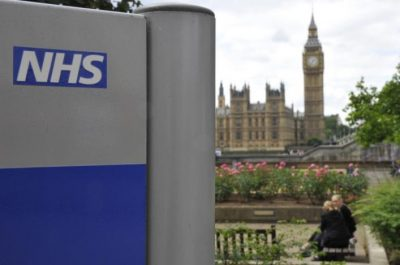 A NHS sign is seen in the grounds of St Thomas' Hospital in London