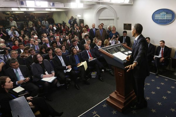 President Obama responds to a question at his end of the year press conference in the briefing room of the White House in Washington