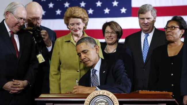 Obama signs food stamp cuts into law