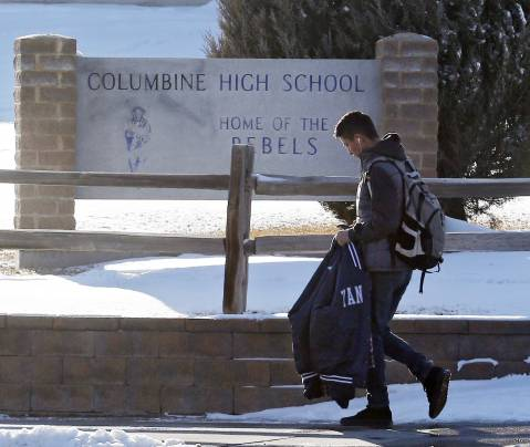 A student leaves Columbine High School in Littleton, Colo., on Thursday, Jan. 23, 2014. (AP Photo/Ed Andrieski)
