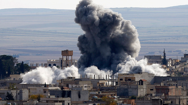 An explosion following an air strike is seen in western Kobani neighbourhood (Reuters / Osman Orsal)