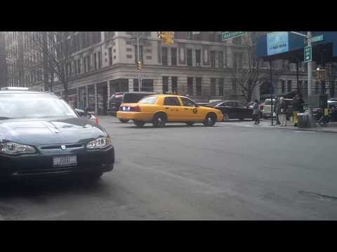 "Undercover NYPD ""yellow cab"" cruiser blocking the a street in Manhattan"