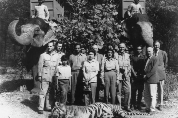 "Prince Philip (left) and the Queen (center)  ""conserving"" a tiger in India, 1961"