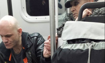Photo captures elderly woman's kind gesture to aggressive man on train