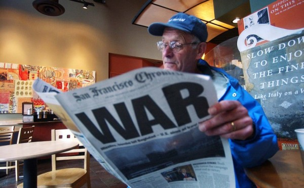 **FILE** FOR USE AS DESIRED WITH MARCH 20, 2003 ANNIVERSARY OF THE U.S.-LED INVASION OF IRAQ** Ray Jacques reads the San Francisco Chronicle's war special section inside a Starbucks coffee shop in San Francisco, in this March 20, 2003 file photo. (AP Photo/FILE/Marcio Jose Sanchez)