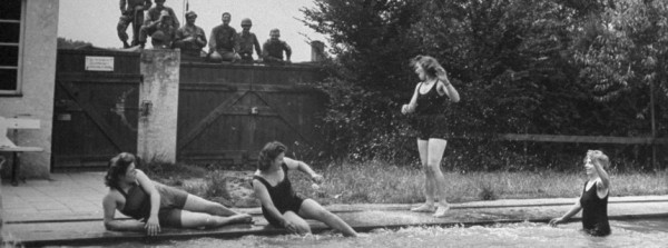 Fraternization of American troops with German civilians; GI's watching girls swimming. (Photo by Ralph Morse/The LIFE Picture Collection/Getty Images)