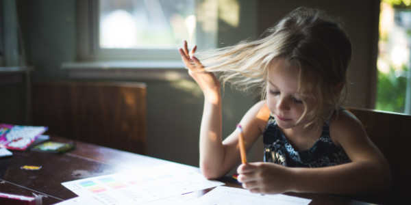 Girl with Pencil doing Homework