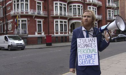 Hero With a Bullhorn Reads the Internet to Julian Assange From the Sidewalk