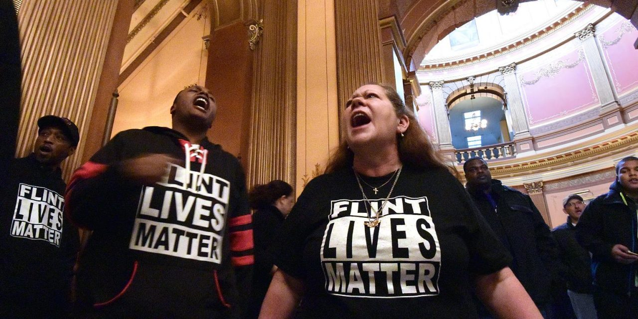 Emergency managers, city officials charged in Flint water crisis