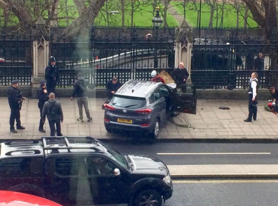 Car Crashes Into Parliament Gates